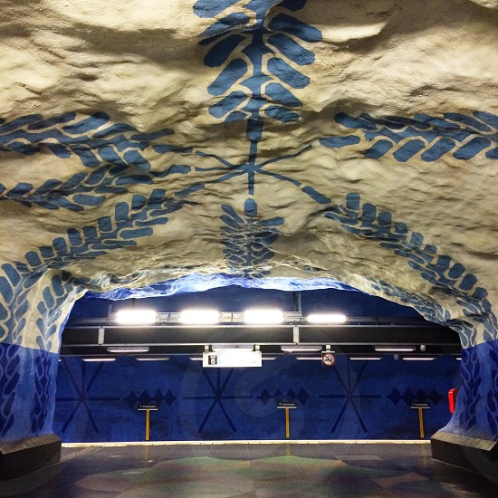 Stockholm tunnelbana station with blue artwork photo