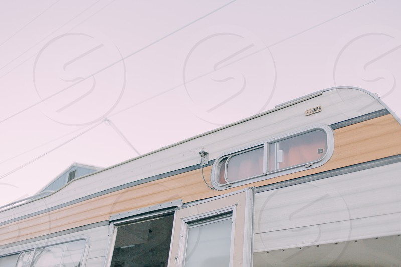 low angle photography of white brown camper trailer during daytime photo