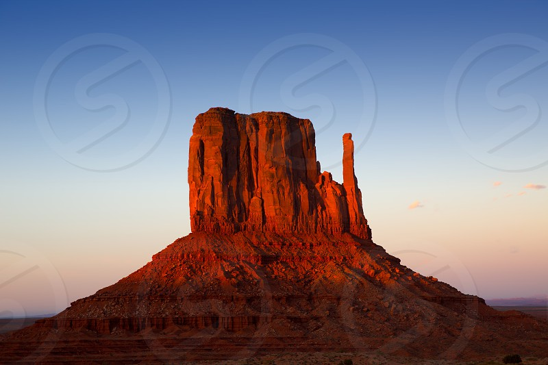 Monument Valley West Mitten at sunset blue sky Utah photo