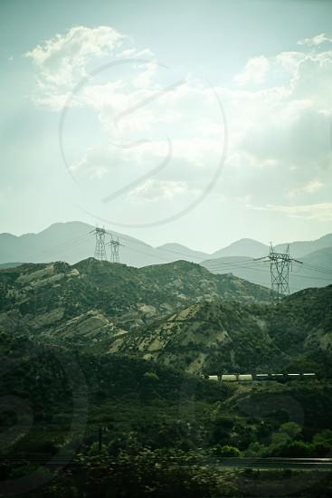Trains twist through Southern California Mountains along the I-15 photo