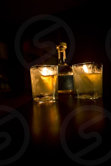 2 shot glasses filled with yellow liquor photo