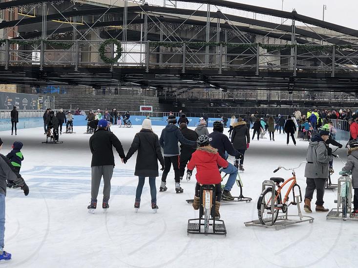 Winter sports ice rink ice skating ice bikes outdoors fun recreation winter anonymous families Buffalo New York photo