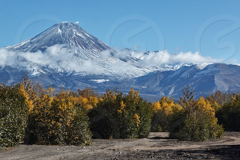 Beautiful volcanic landscape: autumn view of active Avacha Volcano on a sunny day. Russia Far East Kamchatka Peninsula. photo
