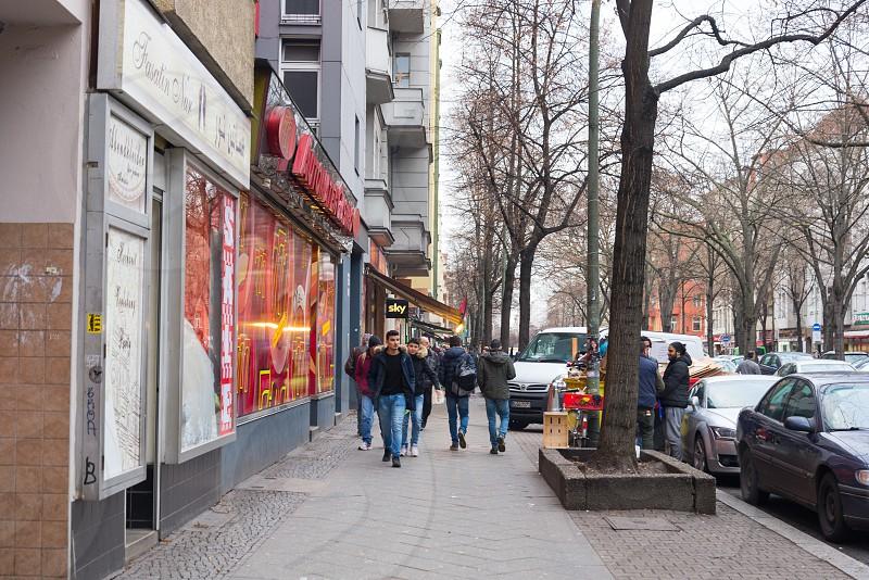 Scene around Azzam shop famous Arab supermarket and kebab restaurant consist of supermarket restaurant and Arab street coffee inside Neukolln Neighborhood in Berlin Germany photo