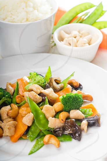 fresh chicken and vegetables stir fried with cashew nutstypical chinese dish photo