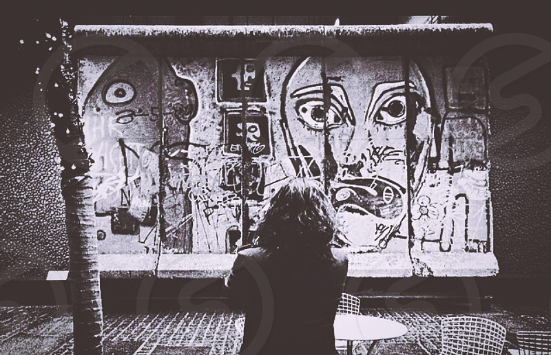 Best friend in front of a section of the Berlin Wall photo