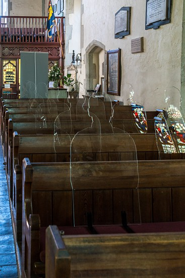 ALFRISTON SUSSEX/UK - JULY 23 : Perspex Silhouetes of servicemen who laid down their lives in the first world war inside St Andrew's Church in Alfriston Sussex on July 23 2018 photo