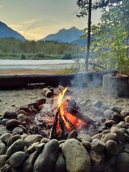 Campfire in mountains photo