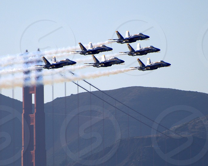 six fighter jets formation near Golden Gate Bridge during daytime photo