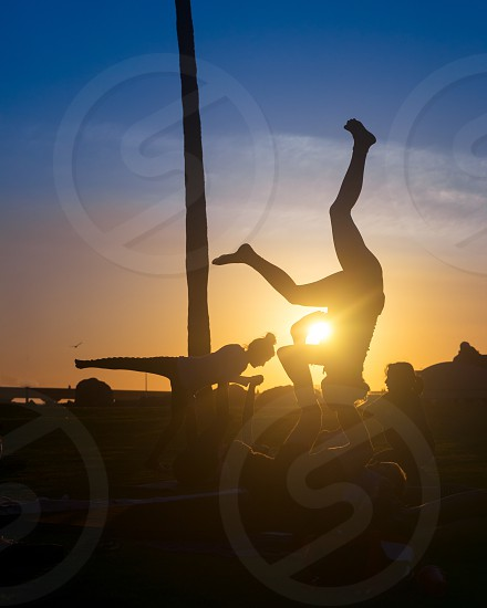 Nothing more relaxing than some yoga on the beach during those golden hours photo