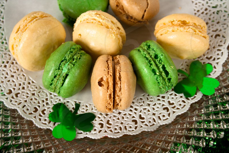 Plate of green and white macaroons with shamrocks photo