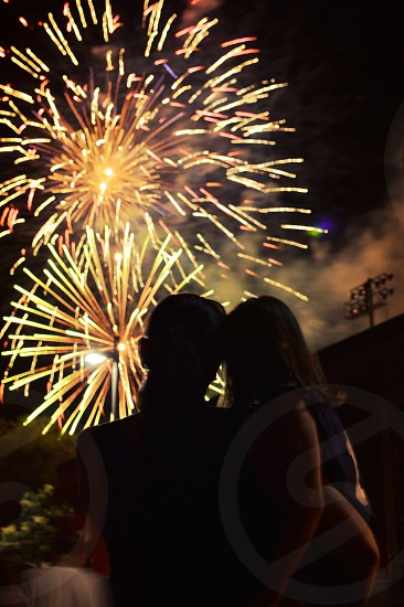 woman and girl watching fireworks photo