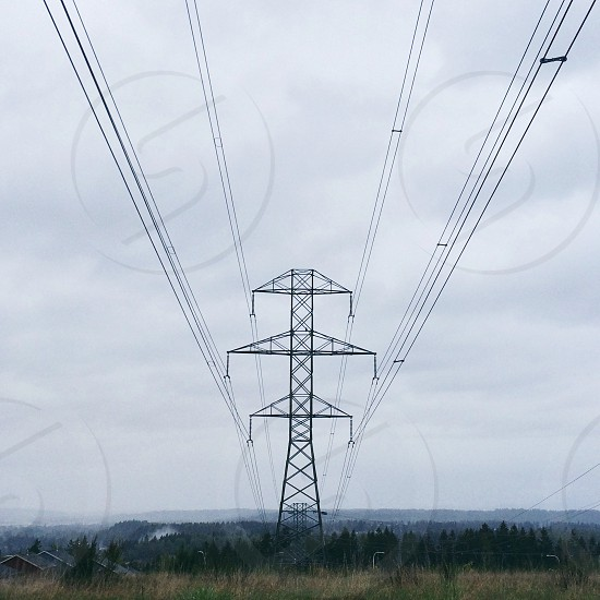 black metal tower with black electrical wires photo