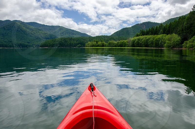 Red canoe on lake photo
