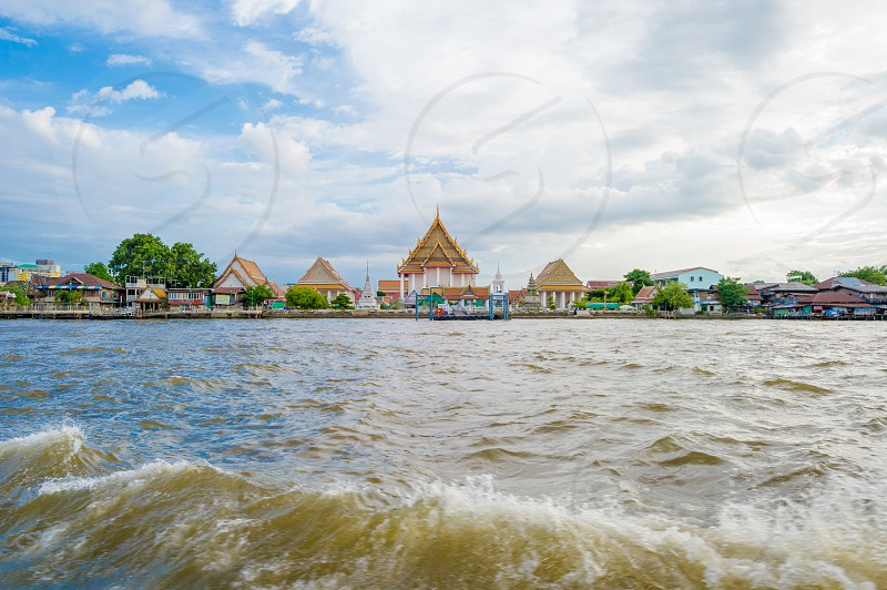 Buddhist temple on the river in Bangkok Thailand. photo