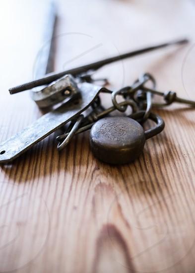 Rusty rustic tabletop wooden padlock rusty rust chain photo