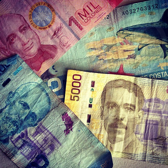 """""""Trade off"""" Currency from Costa Rica sits in a brightly colored pile. photo"""