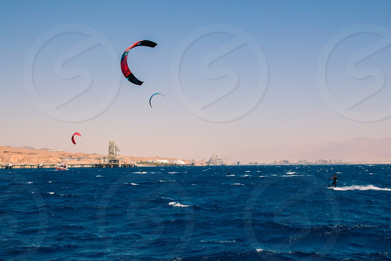 Windsurfers sailing in the Red Sea.Near the beach of Eilat Israel. photo