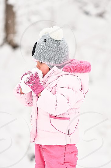 WINTER WONDERLAND | A little girl taking advantage of a snow ball!  One of my favorite images love her rosy cheeks! photo