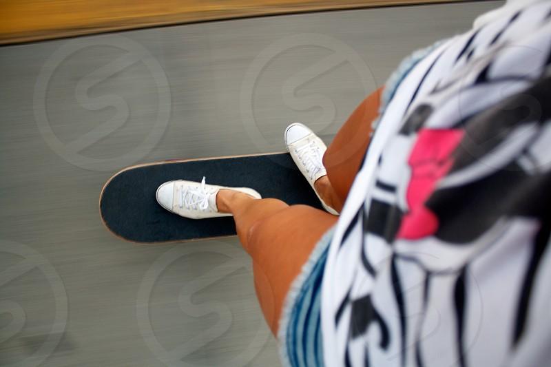 woman riding skateboard photo