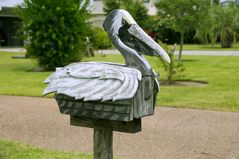 Pelikan mail post wooden mailbox in Texas artistic custom mailboxes    photo