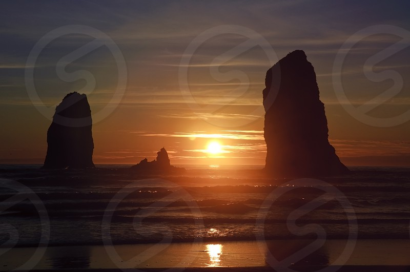 sunset view on beach with 2 rock islet photo