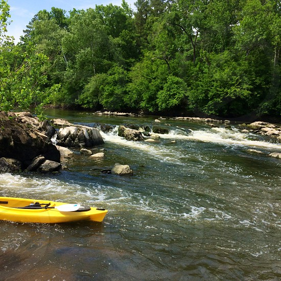 A kayak among some rapids in the Cape Fear River of North Carolina. photo