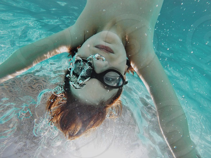 woman with diving glasses in front photo