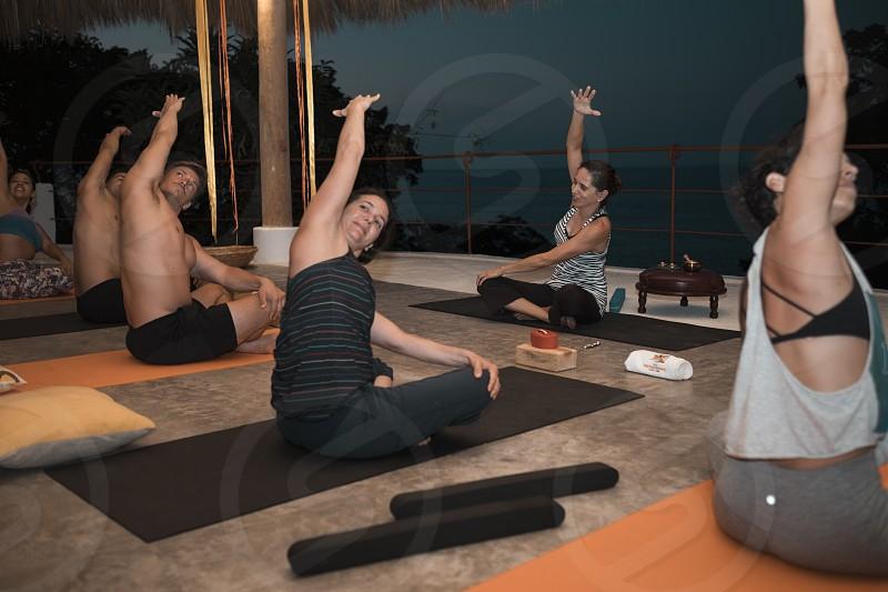 Group of people practicing. Yoga retreat Puerto Vallarta - Mismaloya Mexico photo