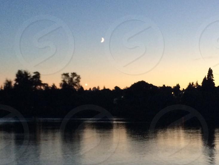 Chasing the light moon crescent lake sunset photo