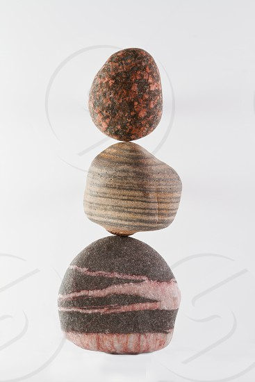 Three pebbles balanced on one another. No photoshop trickery. photo