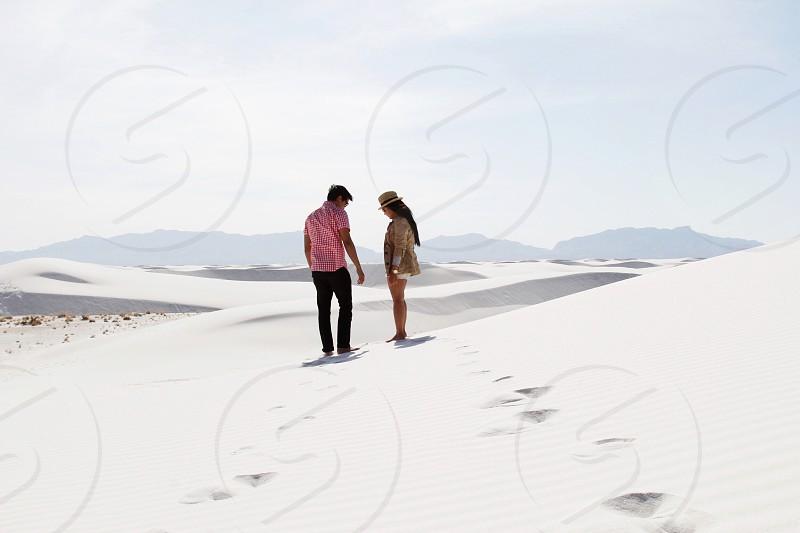 men and woman on dessert photo