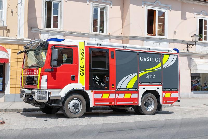 European firefighting truck in street in front of buildings photo