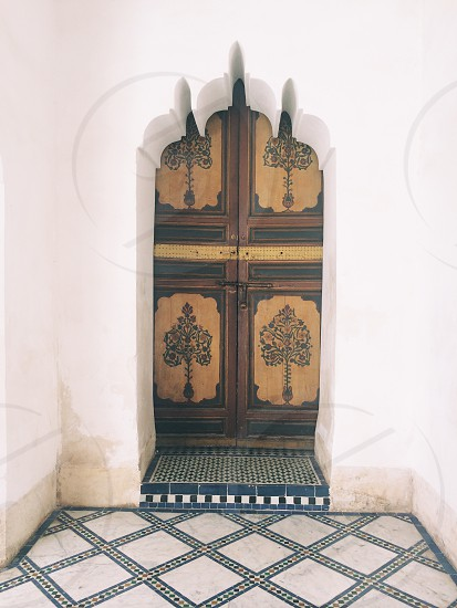 Arched doorway in Marrakech | Morocco architecture pattern tile photo