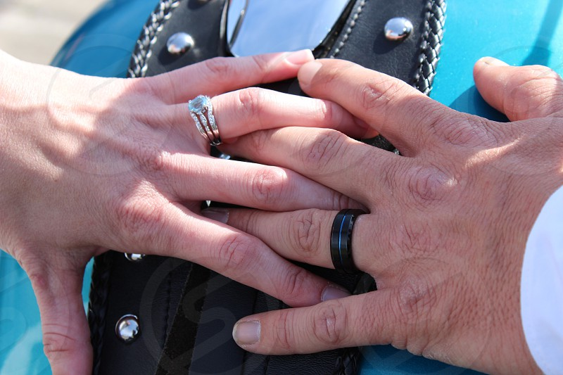 Married couple in love with hands together on a motorcycle. photo