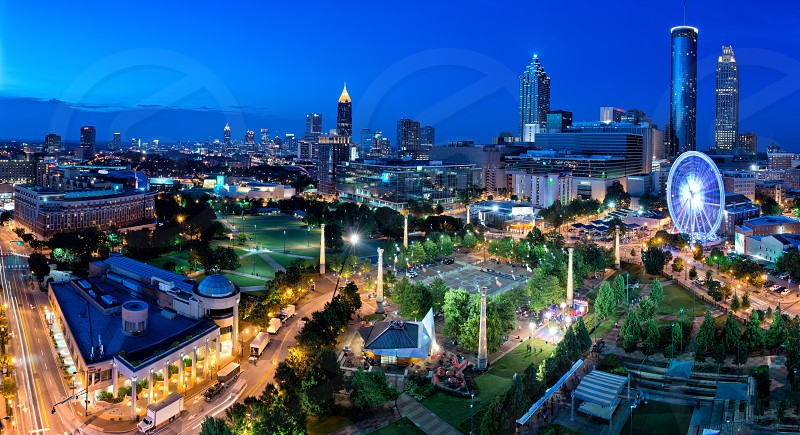 The city of Atlanta from the top of CNN Center featuring Centennial Olympic Park and the Skyview Ferris wheel. photo