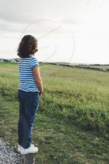 Girl looking at sunset girl sunset kid harmony balance tranquility compatibility symmetry alone loneliness safety backlight photo