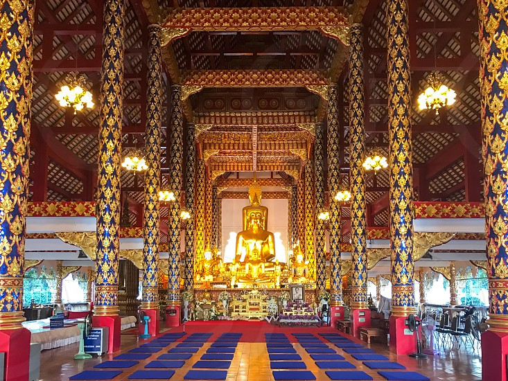 Buddha images inside chapel of Wat Suan Dok a Buddhist temple in Chiang Mai Thailand photo