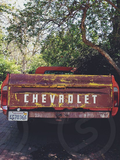 red chevrolet truck parked photo