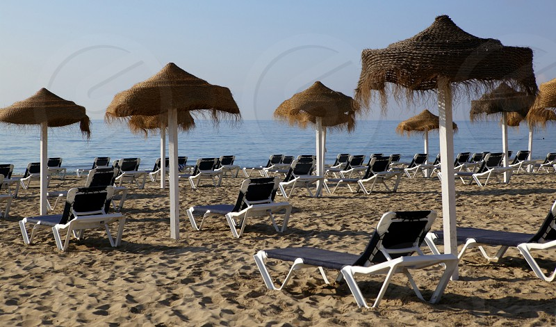 Ibiza Beach evening with umbrellas Spain touristic landmark photo