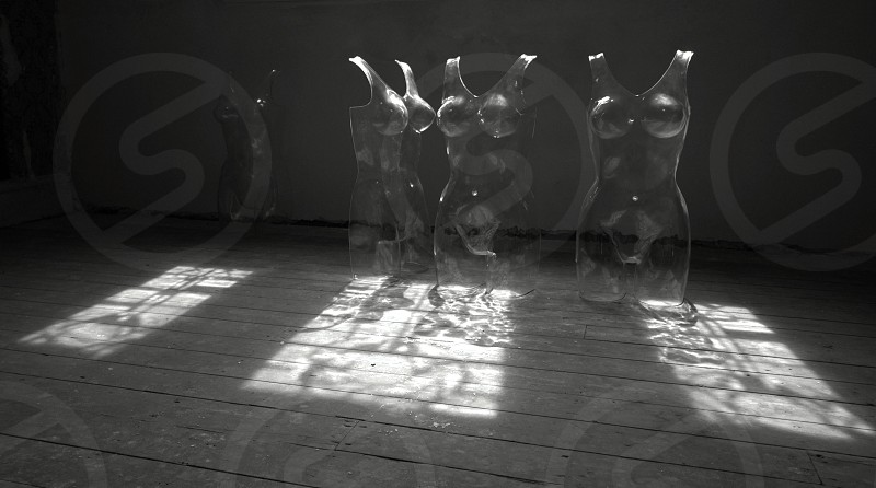 modern black and white plastic mannequins indoor shadows light wood  photo