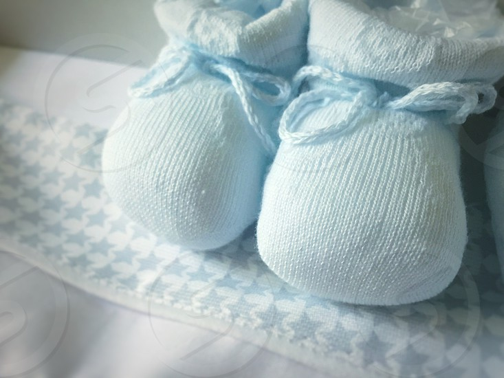 baby newborn nobody pair clothing white small cute footwear infant background new soft shoe foot little child tiny two boy clothes slipper birth toddler blue closeup object booty isolated ribbon shoes slippers boot childhood pastel birthday booties cloth kid accessories children cotton fabric textile born childcare photo