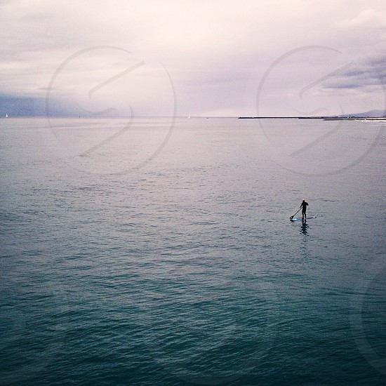 body of water and white clouds photo