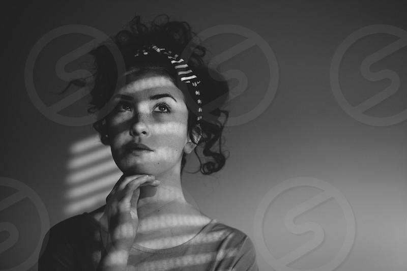 Young beautiful girl in window light photo