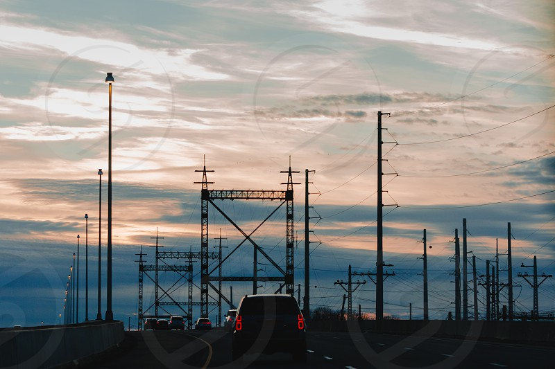 Driving in an industrial area during a sunset. photo