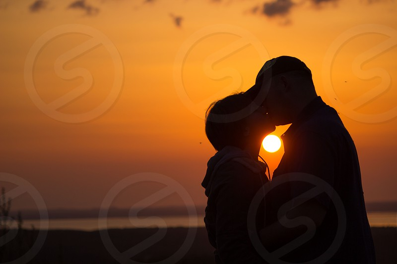 Sharing a kiss with my hubby in the sunset. This definitely makes me happy. photo