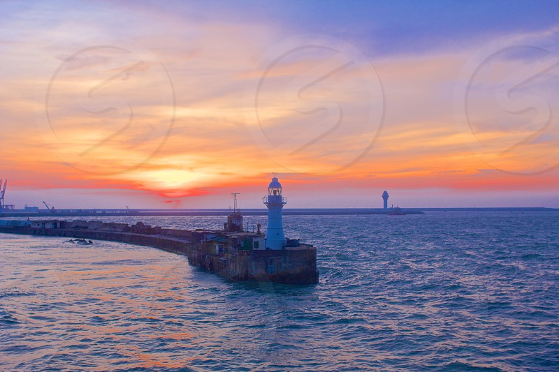 Light houses marking the entrance to Colombo Harbor Sri Lanka.  Pastel sunset with vivid colors. photo