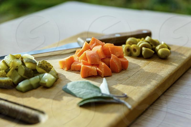 Vibrant carrots cucumbers olives photo