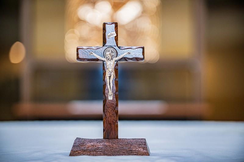 Jesus Christ on a wooden cross statue photo