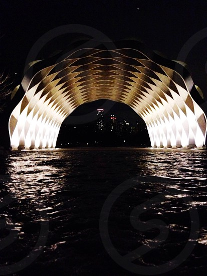 white arched sculpture over water photo